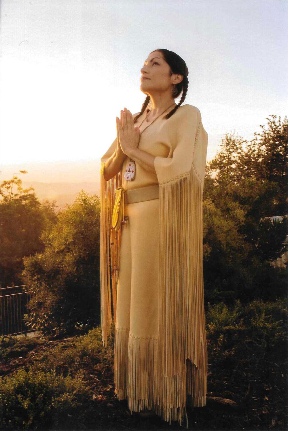Monica Ortiz in Native American regalia