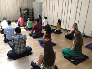 Monica Ortiz leading a mindfulness class at Google's New York campus